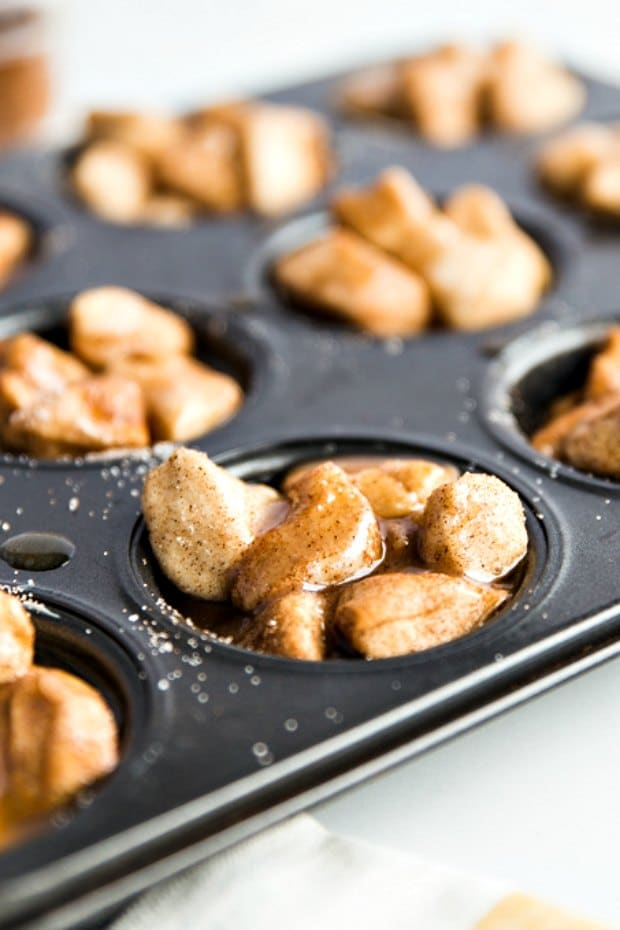 monkey bread batter pieces in muffin tin