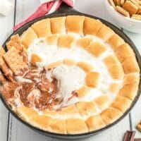A bowl of food on a plate, with S'more