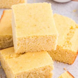 close up shot of slices of Cornbread recipe on a wooden board
