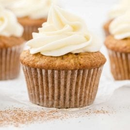 side shot of carrot cake cupcakes with cream cheese frosting