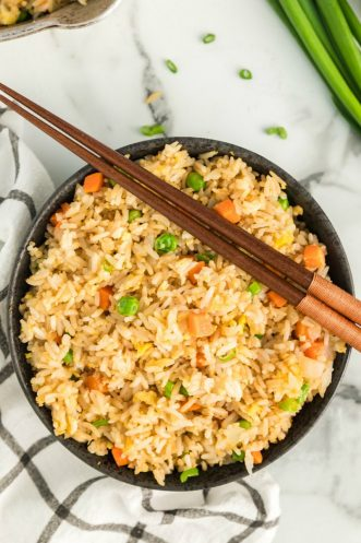 fried rice in a bowl with chopsticks