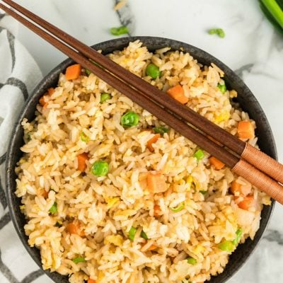 A plate of food with rice and vegetables, with Fried rice