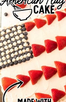 close up shot of American flag cake topped with strawberries and blueberries in a baking dish