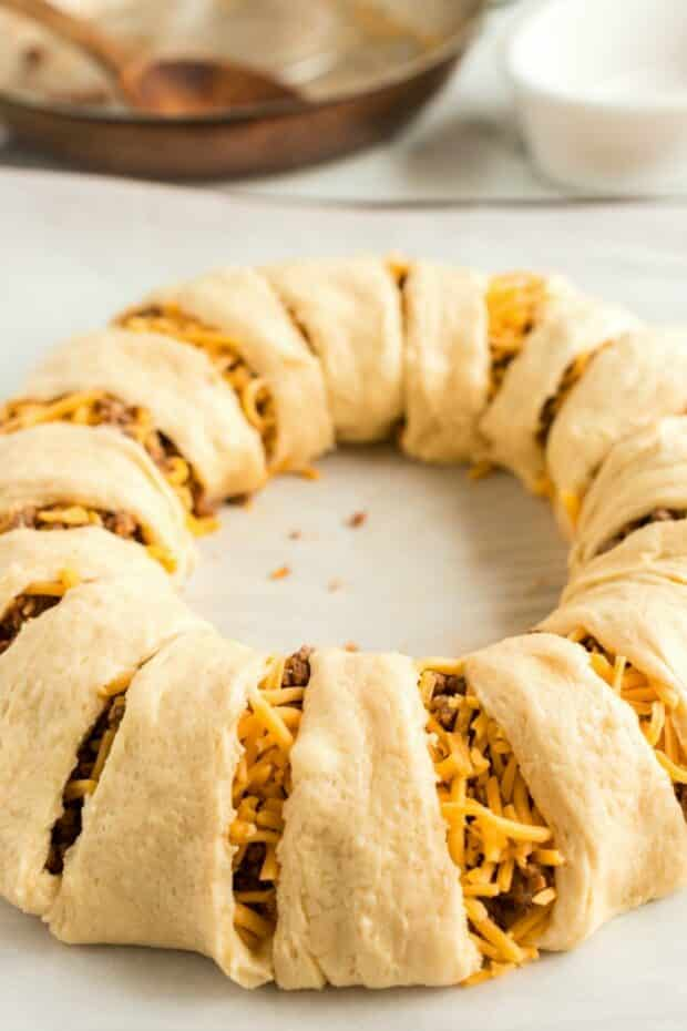 uncooked taco crescent roll ring on baking sheet