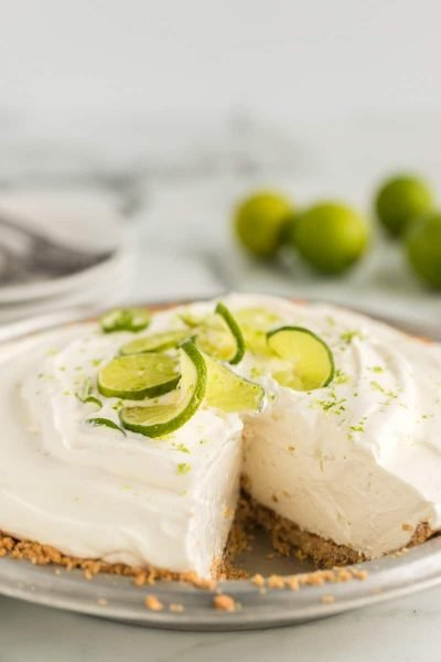 A close up of a slice of cake on a plate, with Lime and Pie