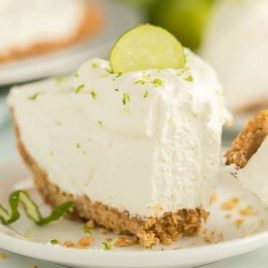 A close up of a piece of cake on a plate, with Key lime