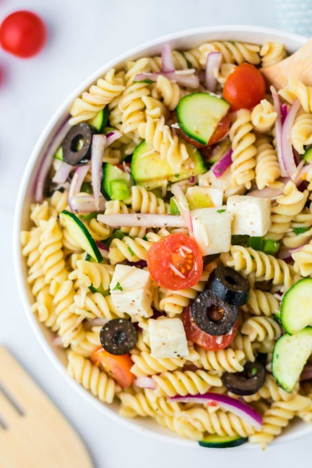 A plate full of food, with Salad and Pasta