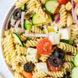 A plate of food, with Pasta and Salad