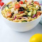 A bowl of fruit salad, with Pasta salad