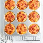close up overhead shot of pizza muffins in a muffin pan