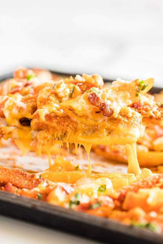 A close up of food, with Chicken and Cheese
