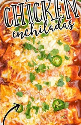 close up overhead shot of chicken enchiladas garnished with cilantro and jalapeños in a baking dish