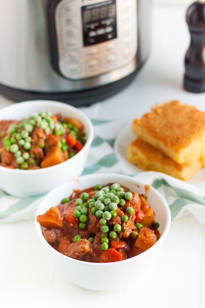 A plate of food on a table, with Stew and Pea