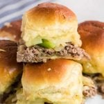 close up shot of Philly cheesesteak sliders stacked on top of each other
