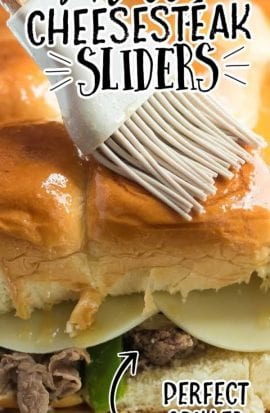 close up shot of Philly cheesesteak sliders with butter being brushed on the buns