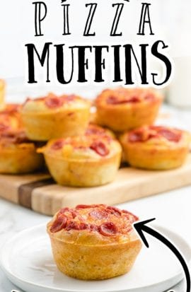 close up shot of pizza muffins on a plate and some in the background on a wooden board