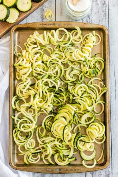 zucchini noodles on a baking sheet