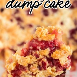 close up shot of Cherry Pineapple Dump Cake on a large wooden spoon