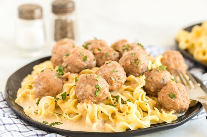 A plate full of food, with Meatball and Cream