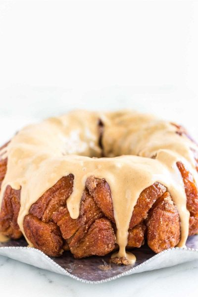 close up shot of Peanut Butter Monkey Bread topped with glaze