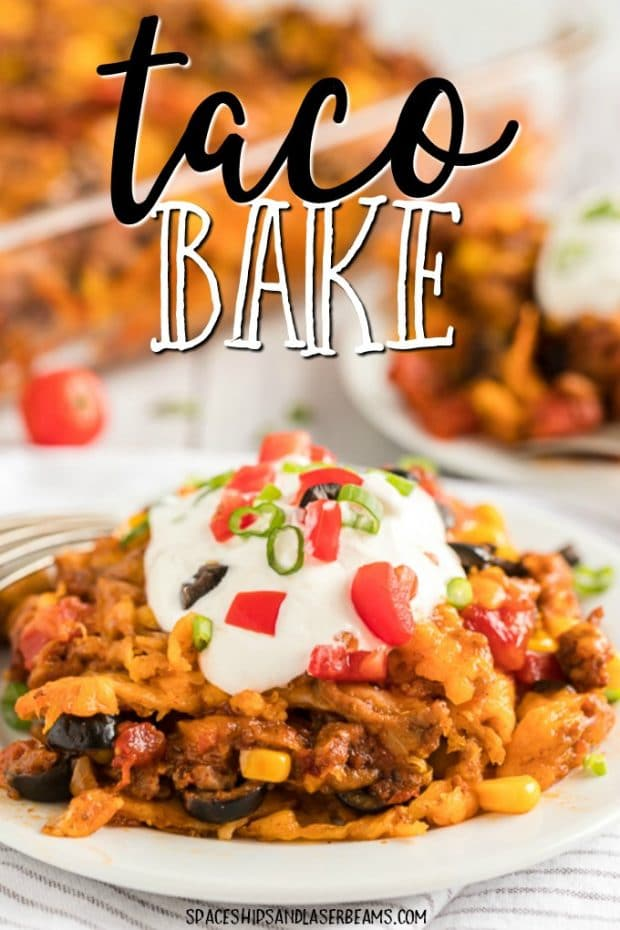 taco bake on a plate with dollop of sour cream on top