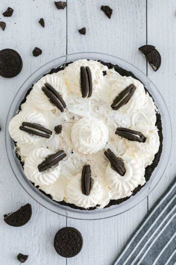 A close up of a cake on a plate, with Pie and Oreo