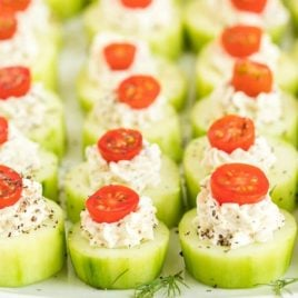A bunch of food on a tray, with Cucumber