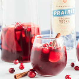 A bottle of wine and a bowl of fruit, with Sangria