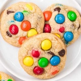 close up overhead shot of a plate of m&m cookies