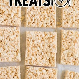 close up overhead shot of Rice Krispie Treats lined on top of parchment paper