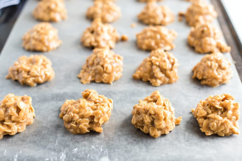baking sheet with rows of peanut butter no bake cookies