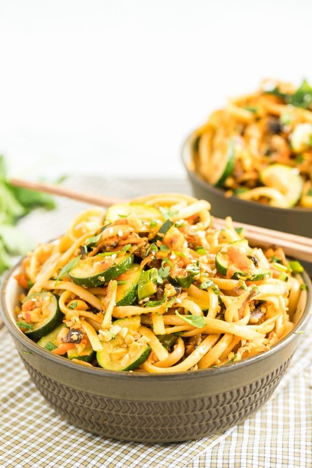 A bowl of food with broccoli, with Noodle and Linguine