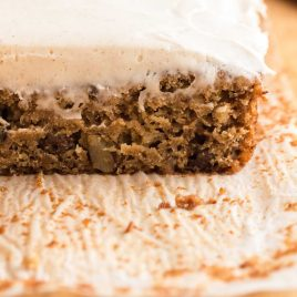 close up shot of Applesauce Cake topped with cream cheese frosting
