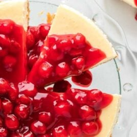 close up overhead shot of Cheesecake topped with a cherry glaze