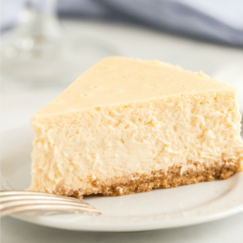 A piece of cake on a plate, with Cheesecake