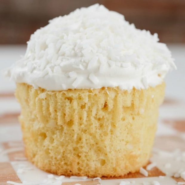 A close up of a piece of cake on a plate, with Coconut and Cupcake