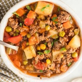 close up overhead shot of a bowl of Hamburger Soup with a spoon