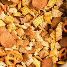 A pile of food on a plate, with Chex and Cooker