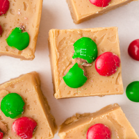 close up shot of peanut butter fudge with m&ms on the top
