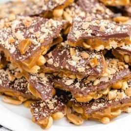 chocolate peanut toffee stacked on top of each other on a plate