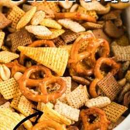 chex mix being cooked in a slow cooker