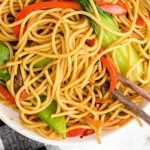 close up overhead shot of lo mein in a bowl with chopsticks