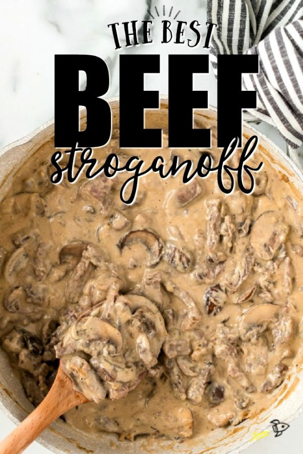 Skillet of beef stroganoff with wooden spoon