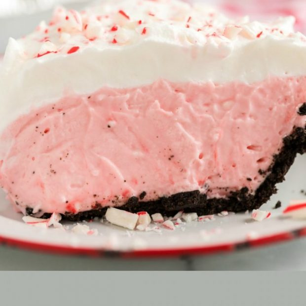 A close up of a piece of cake on a plate, with Candy