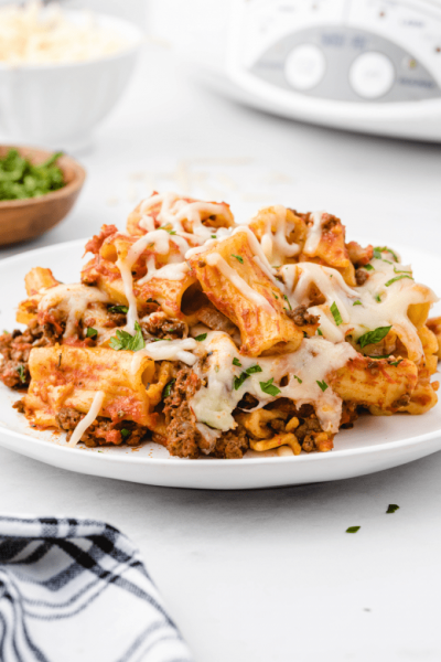 crockpot baked ziti with cheese and parsley on a white plate