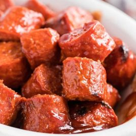 A close up of sausage bites in a bowl