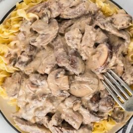 close up overhead shot of a bowl of Beef Stroganoff with a fork