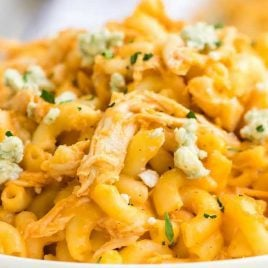 close up shot of a serving of Buffalo Chicken Mac and Cheese garnished with parsley on a plate