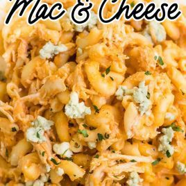 close up overhead shot of a serving of Buffalo Chicken Mac and Cheese garnished with parsley on a plate