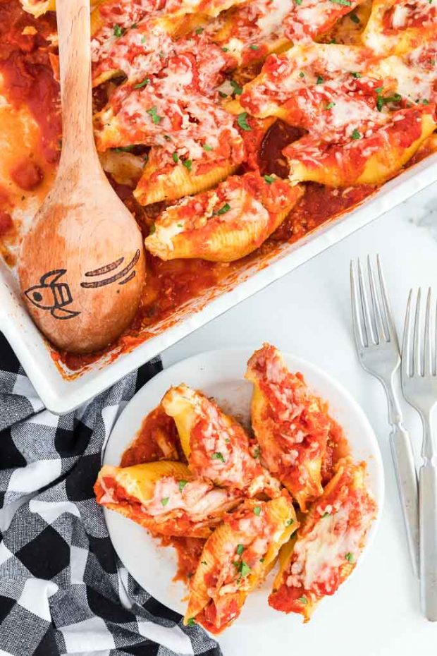 stuffed shells in casserole dish and on a plate